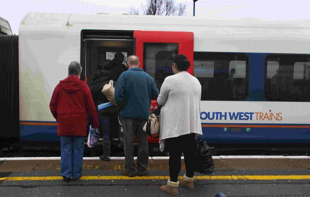 DELAYS EXPECTED: Passengers at Poole Railway Station