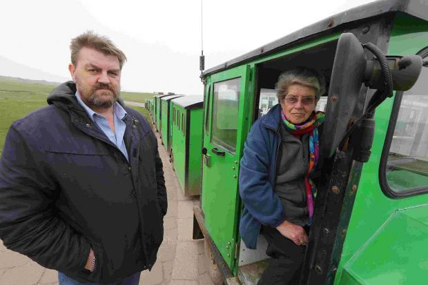 SHOCK: Joyce Faris owner of the Hengistbury Head land train with mechanic Alan Barnard