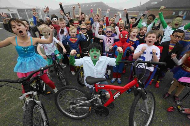 Bournemouth Echo: Excelsior! Pupils at Winton Primary School who rode bikes and scooters to school dressed as superheroes