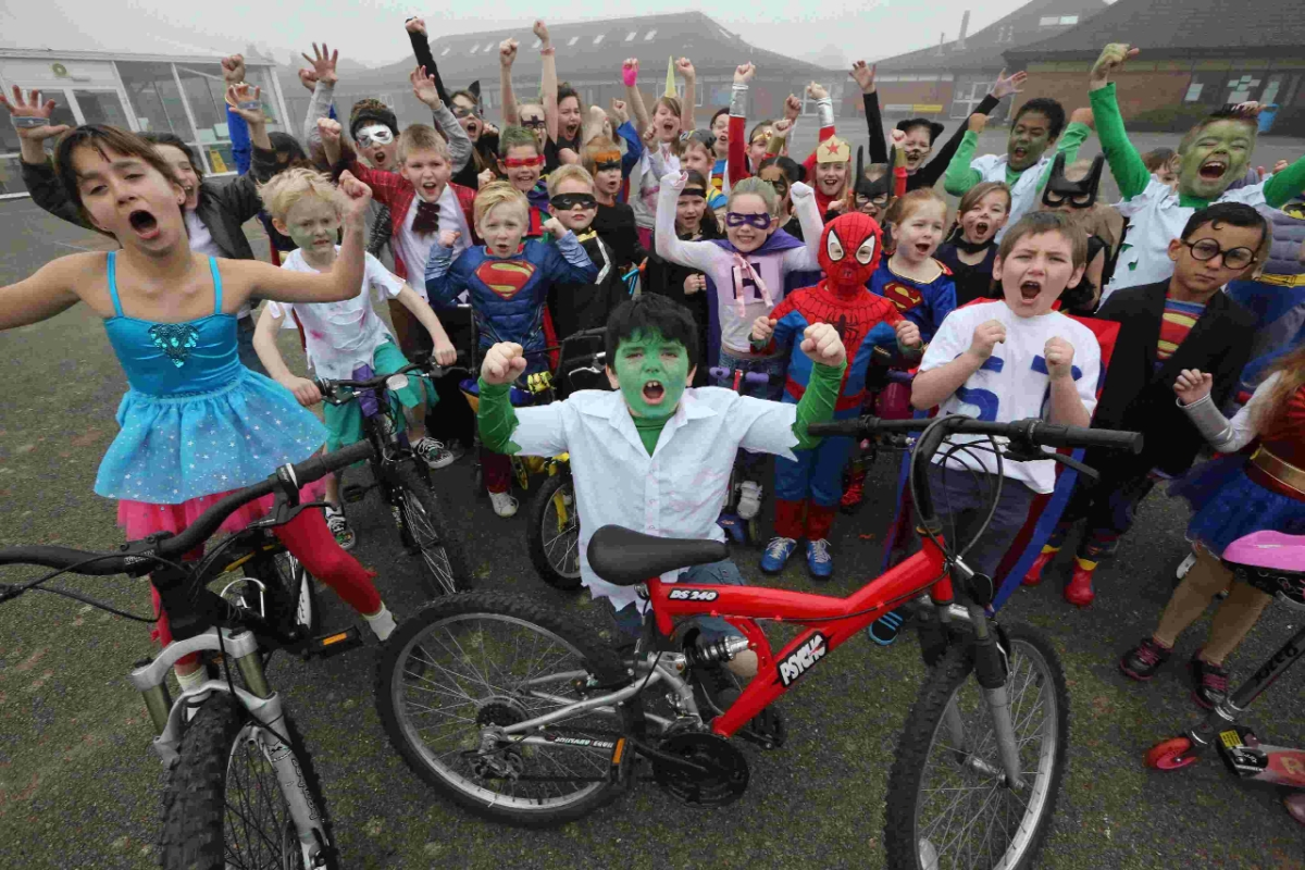 Excelsior! Pupils at Winton Primary School who rode bikes and scooters to school dressed as superheroes