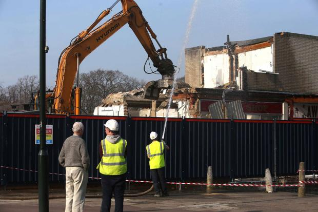 DEMOLITION TIME: The former shopping precinct and Royal Oak pub in Kinson is being demolished to make way for a supermarket
