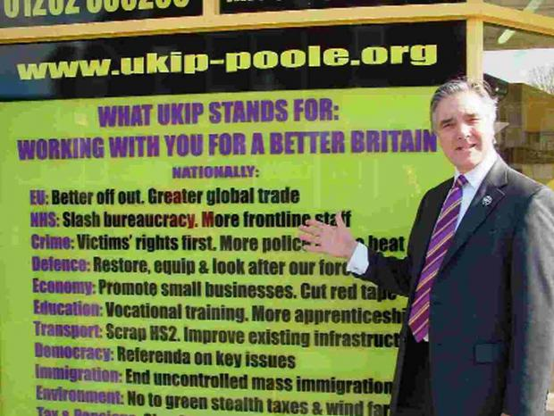 PARTY POLITICAL: David Young shows off a window display at UKIP's new Poole office