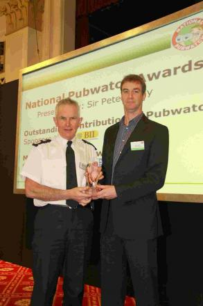 ACCOLADE: Alan Dove receives the Outstanding Contribution Award from Sir Peter Fahy, chief constable of Greater Manchester Police