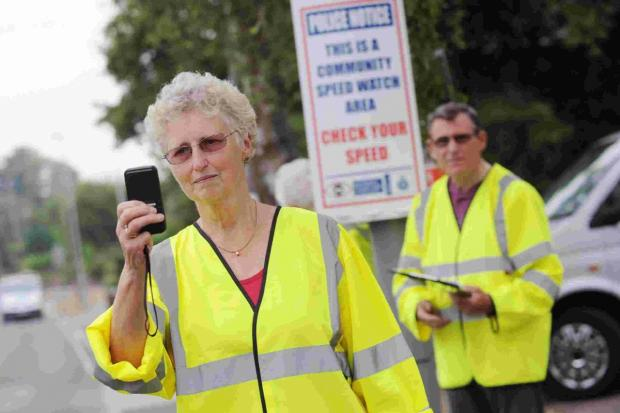 Volunteers conducting speed checks