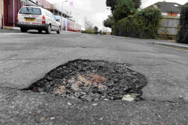 Councils invited to bid of share of £168m pothole fund