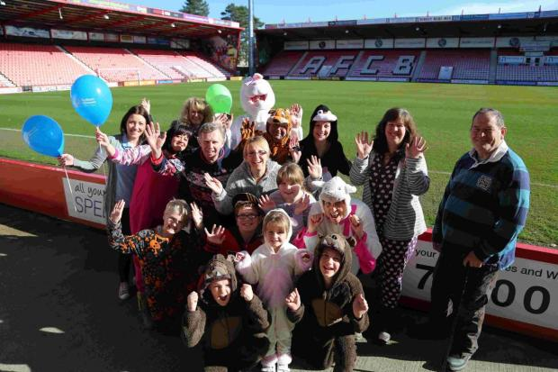 Walkers prepare to take part in the first Autism Wessex Onesie Walk at Goldsands Stadium