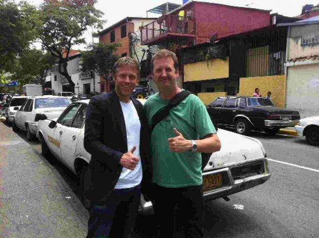 DON'T FORGET THE CARACAS: Adrian and Gunnar in the Venezuelan capital, the final stop on their grand day out