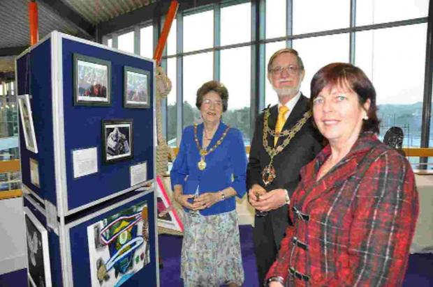 EXHIBITION: From left, the mayoress of Bournemouth, Elaine Cooper, with the mayor, Cllr Rod Cooper, and artist and photographer June Power