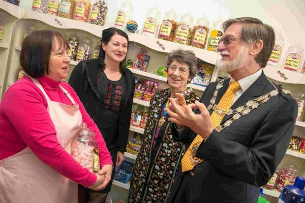 SWEET: The mayoral party meets Sandy Causley, left, at Kinson Treats