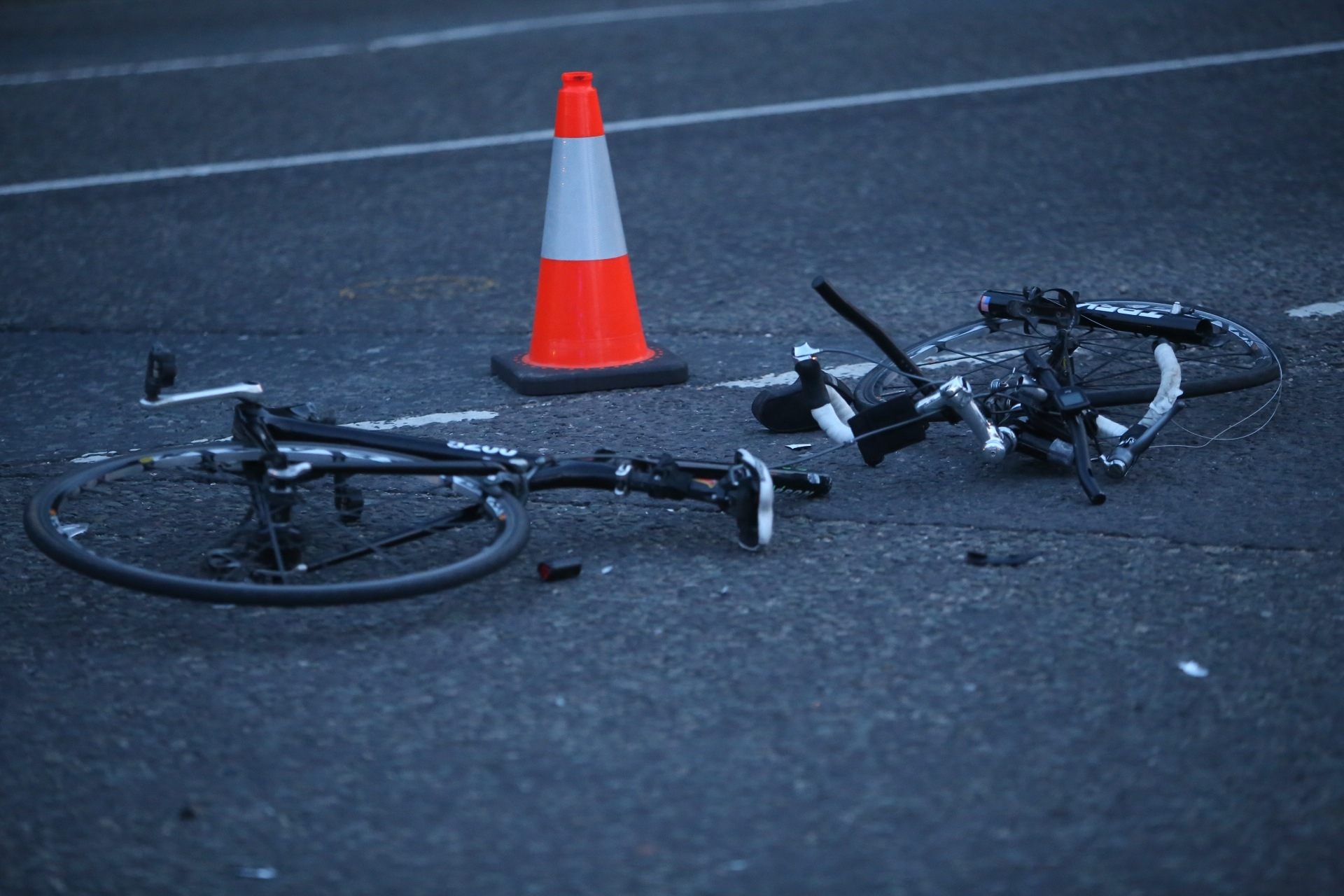 Road closes after cyclist 'seriously' injured in collision with car
