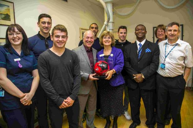 Jeff Mostyn and AFC Bournemouth players meet Angela Schofield and staff in the radiotherapy department