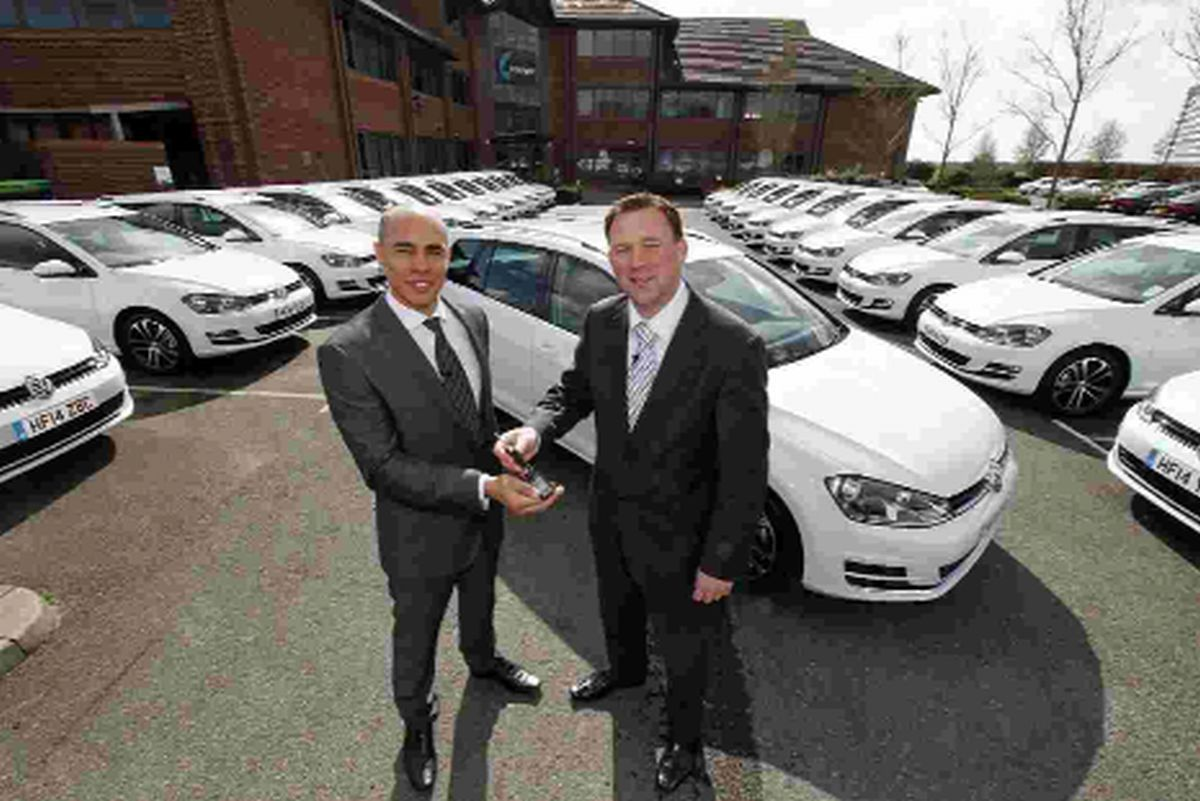 CARS: Neil Carlton, right, business development manager at Breeze Volkswagen, handing over the keys to Adam Sullivan, maintenance director at 4com PLC