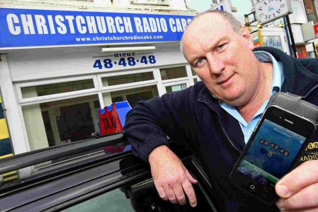 SAFETY FEATURE: Chris Culleton shows off the new Radio Cabs app