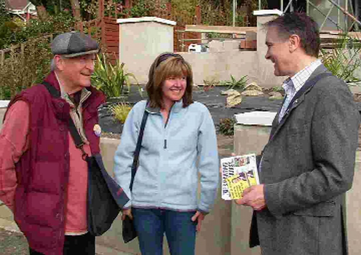 CANVASSING: Tony Woodcock, left, talking to residents with prospective parliamentary candidate David Young