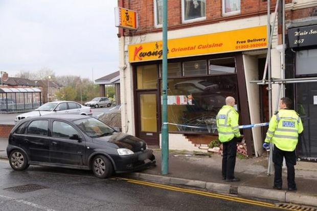 Car crashes into front of Chinese takeaway in Bournemouth