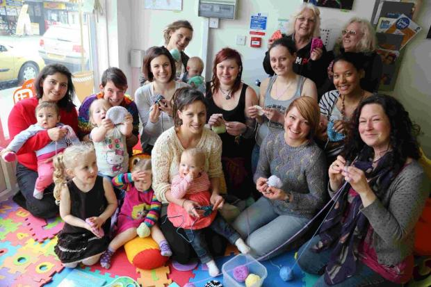 FUNDING BID: Jamii Carmen Prince, front centre, and, centre right, Yummy Mummys creative cafe owner Kasia Mistrzak and volunteers who had spent the day crocheting hats