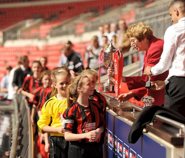 MAGIC MOMENT: Molly Pike receives the trophy at Wembley