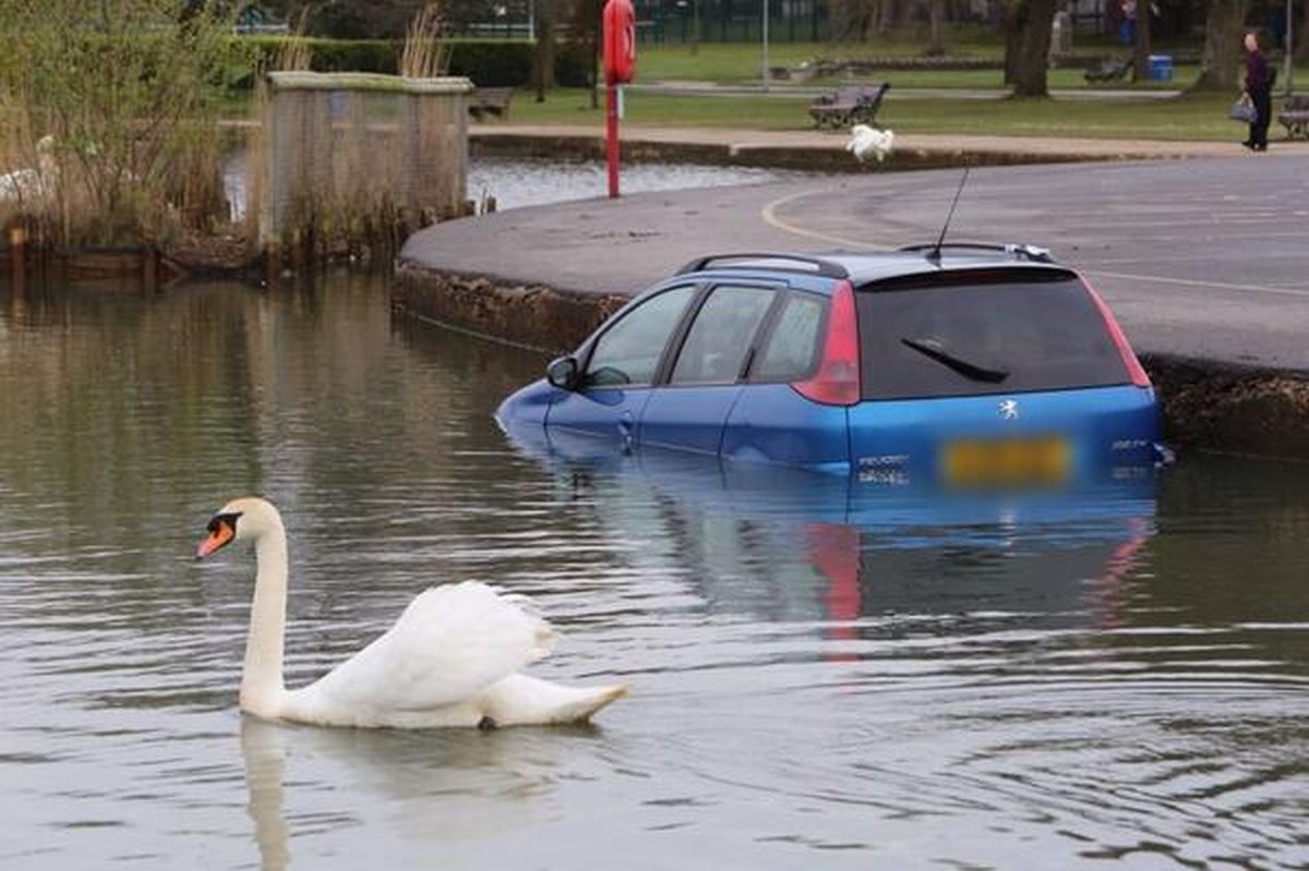 Whoops - car ends up in Poole Park lake after 'handbrake failure'
