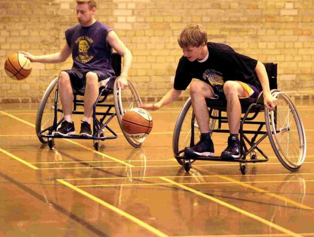 Michael Dronyk and his son Luca enjoy wheelchair basketball at Ferndown Leisure Centre