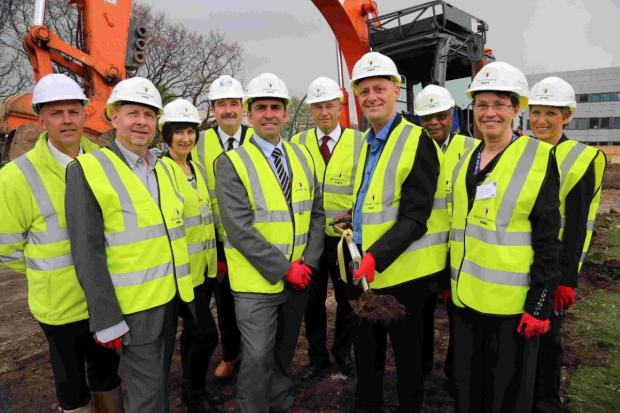 DEVELOPMENT: Neal Stephens, MD of Willmott Dixon, and Lawrence Vincent, Bournemouth and Poole College principal, centre left and centre right, take part in the ceremony