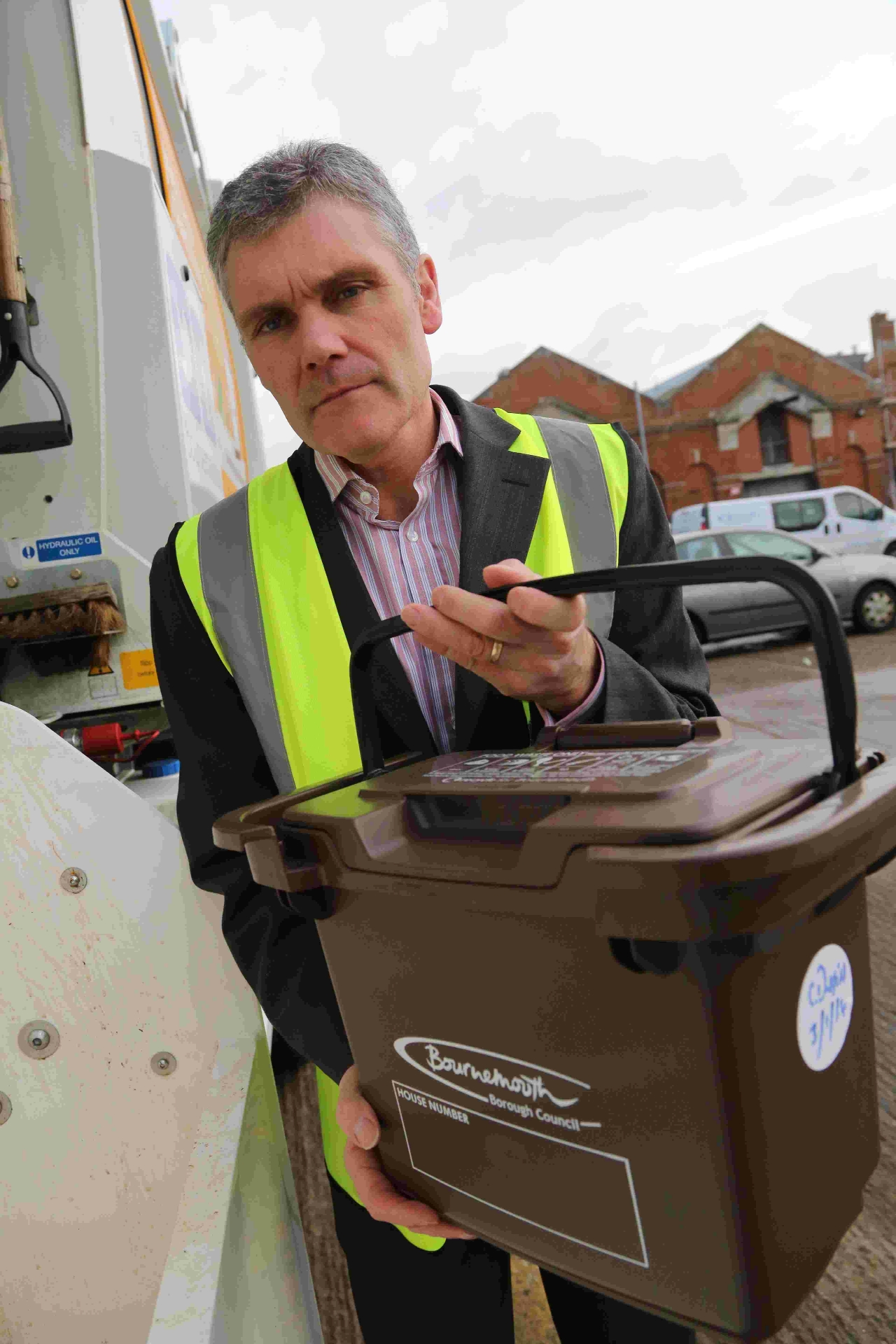 Larry Austin, strategic operations Manager at Bournemouth Council demonstrates the brown food waste bin