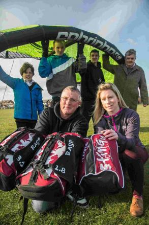 KITE MARK: Gary Hawkins, with Hannah Colston together with charity users and volunteers