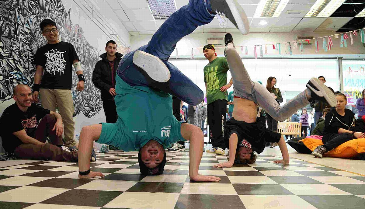HEADS UP: Student Yazan Abbas, left, tries some break dancing with Cameron Cairns, 10