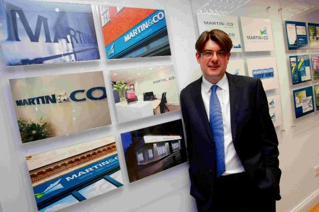 Bournemouth Echo: Martin & Co MD Ian Wilson at the company head office in Bournemouth