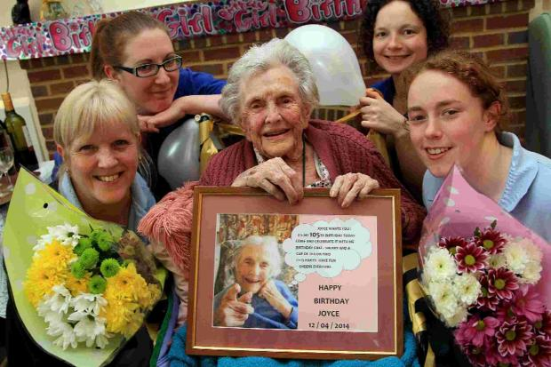 Joyce Massie celebrates her 105th birthday with staff at St Ives House