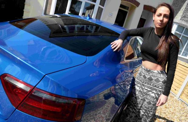 ANGRY: Andrea Morris with her Audi S5 which suffered £5,400-worth of damage