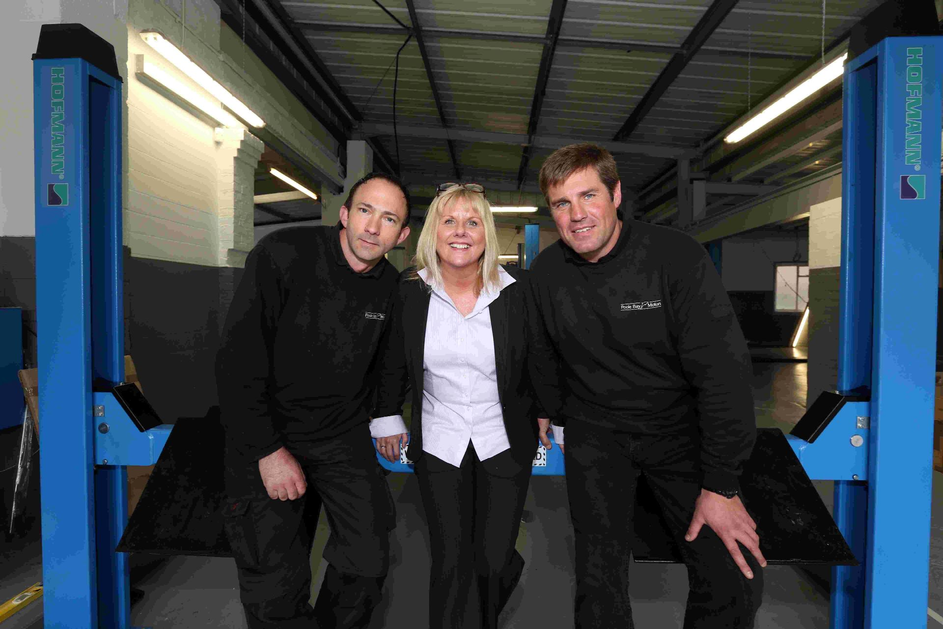 MOTORING ON: Workshop Manager Mark Franks, and directors Lisa Colegate and Scott Mackay of Poole Bay Motors at their new location