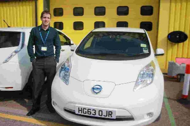 SWITCHED ON: Steven Fall with the electric Nissan Leaf cars