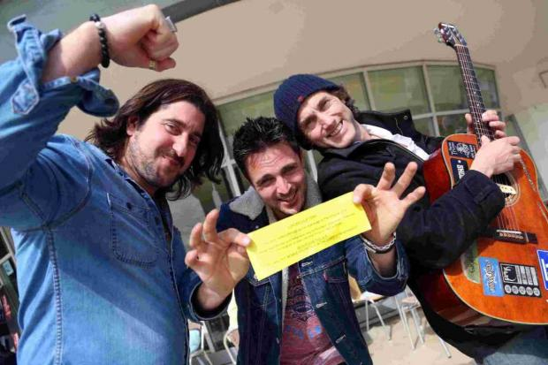 YOU'RE THROUGH: John Smith, centre, celebrates his invite to further auditions in London