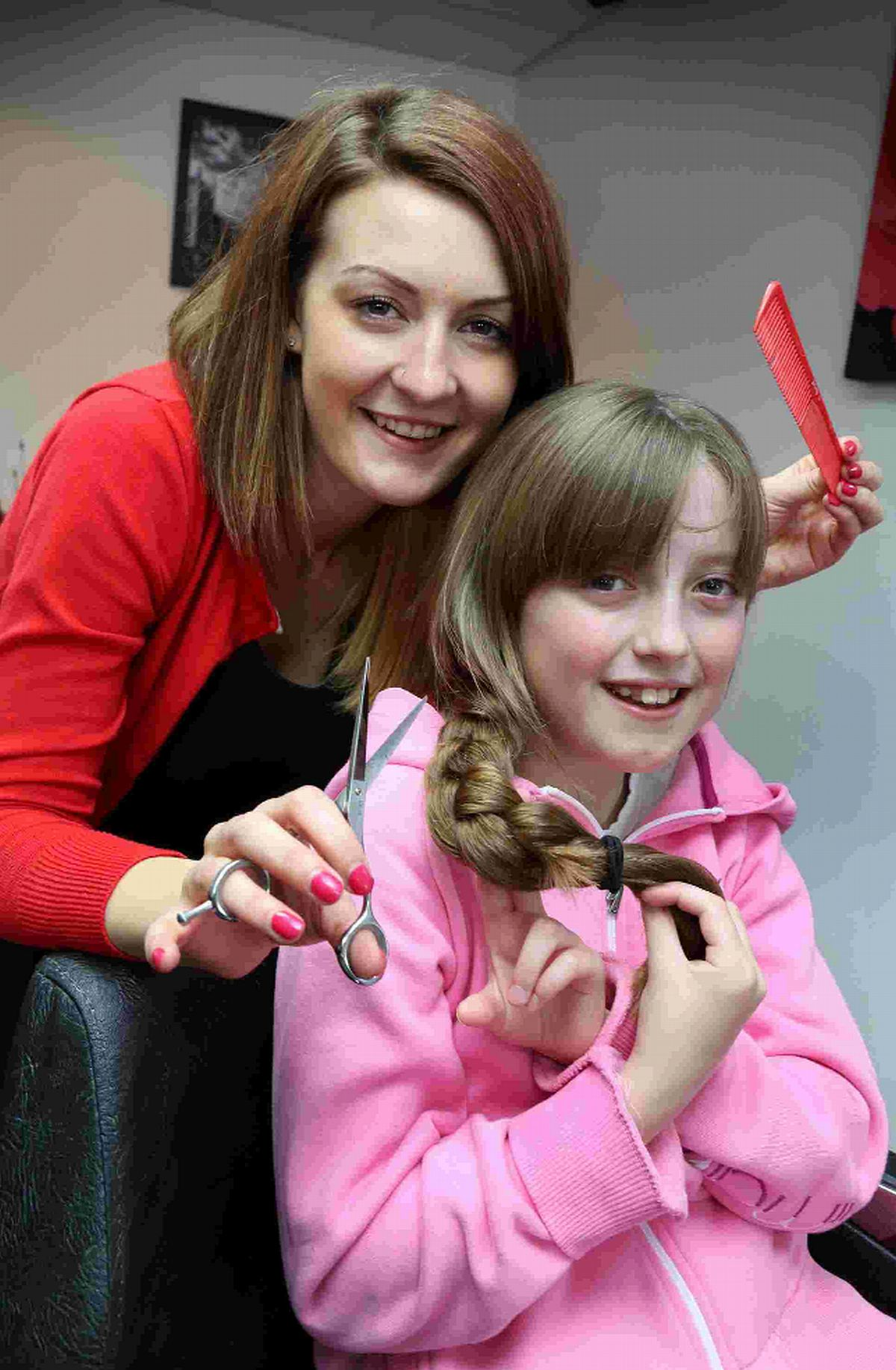 CUT ABOVE: Lauren prepares to have her hair cut off by Louise Harvey of Phase One salon in Creekmoor