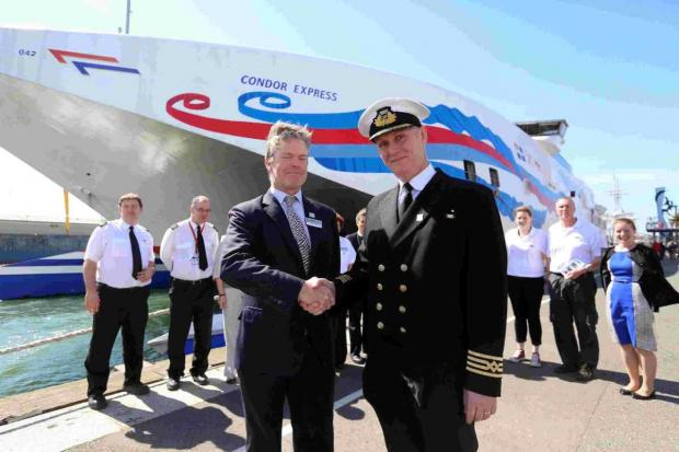 PLAIN SAILING:  Condor chief executive James Fulford and Captain Steve Leake celebrate the 50th anniversary of the company