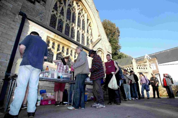 People queue up for food at the Richmond Hill St Andrews church soup kitchen