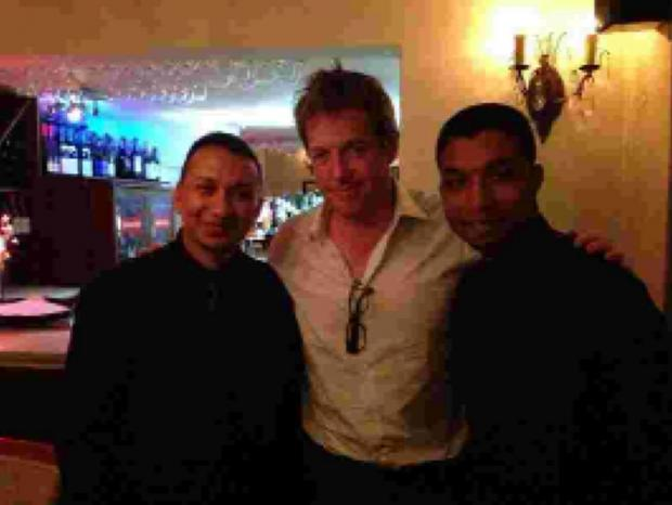 STAR: Hugh Grant with staff at Masala Bay