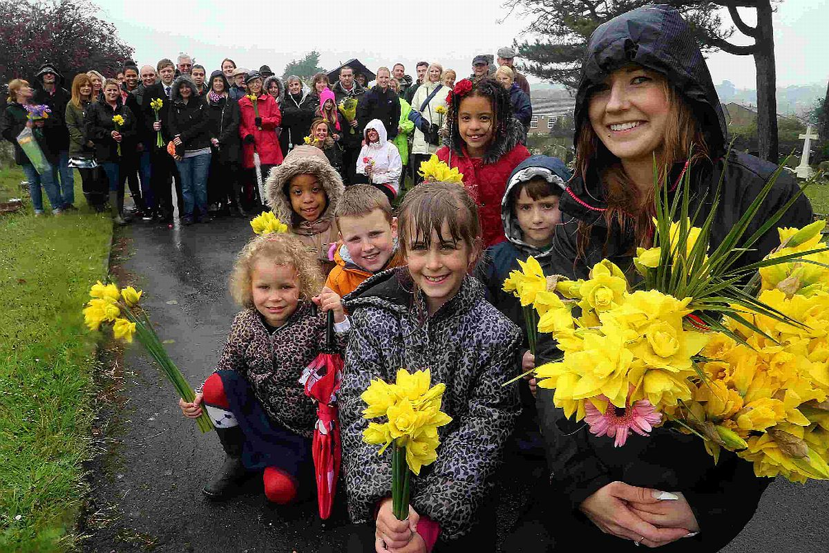 GIVING: Rachael Edis together with volunteers has covered graves in Parkstone cemetery with flowers in an Easter Flowerthon