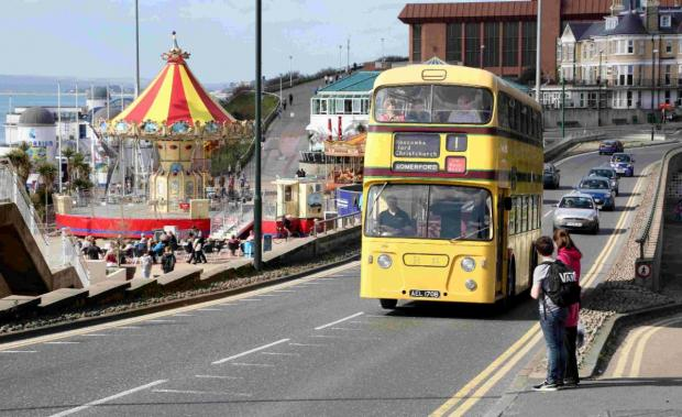 DING DING: Martyn Hearson drives the Number 1 bus through Bournemouth
