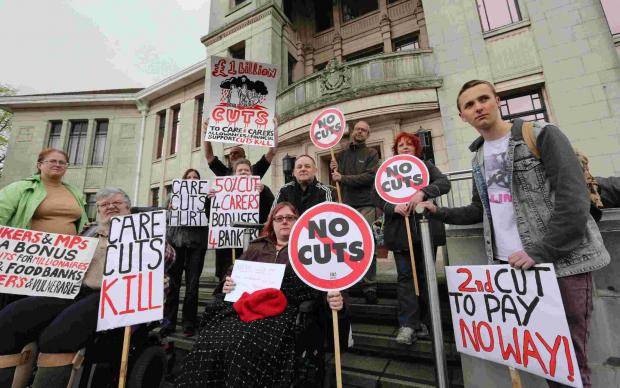 Anti-cuts protesters demonstrate at Poole