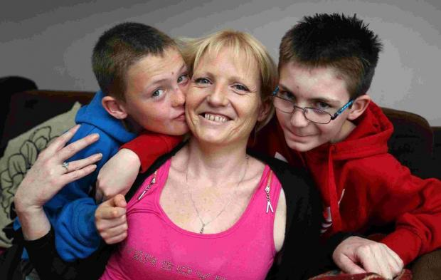 PRAISE: Sam Henney with her sons Callum, 10, and Drew, 12