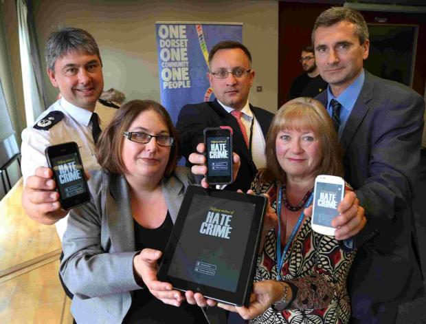 HATE CRIME: Delegates show the new app on their phones and tablets