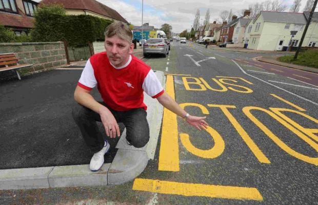 Sean Smith with the new bus stop that has been installed in Ringwood Road in Poole