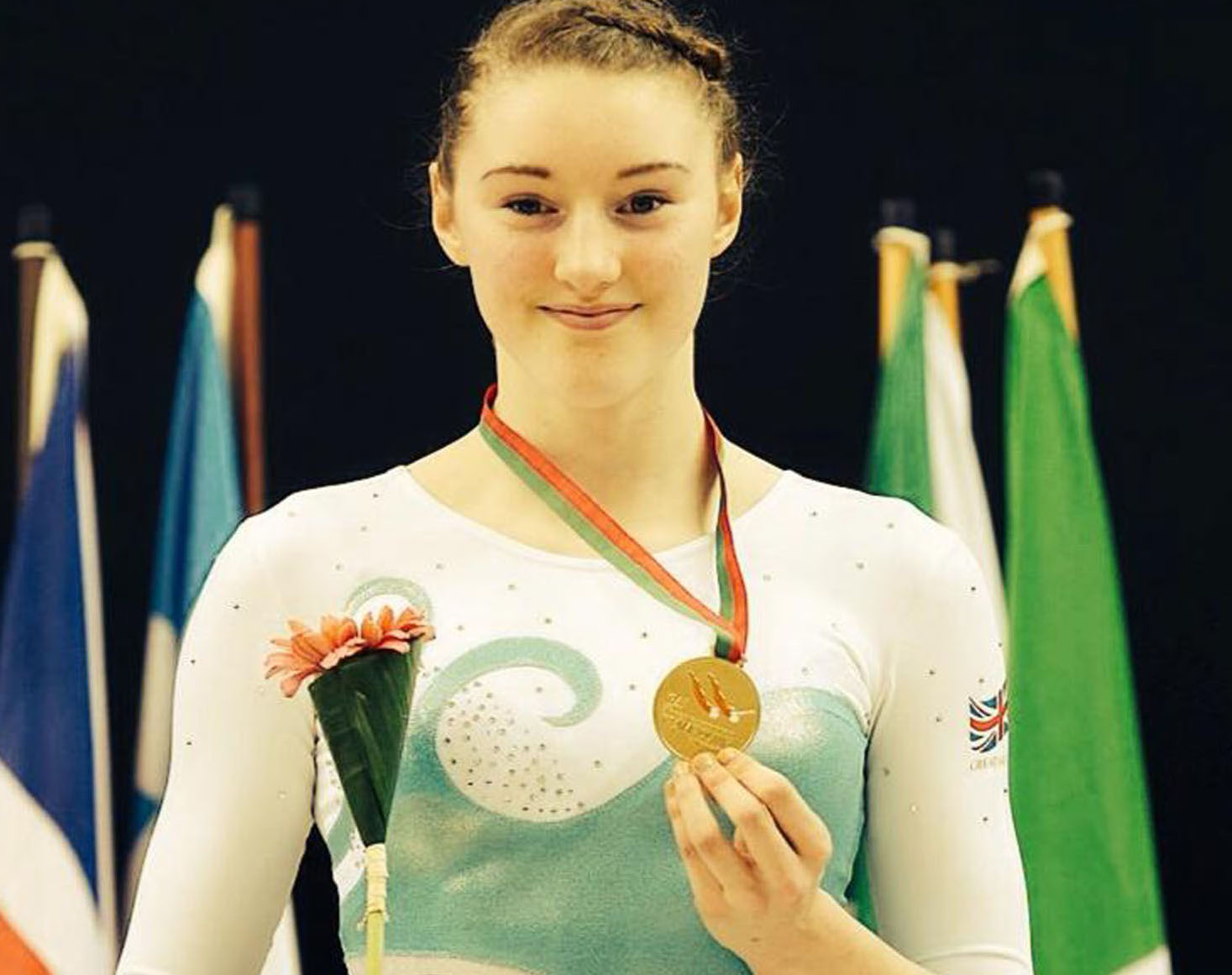 PRIDE OF PLACE: Izzy Songhurst (centre) on the podium in Portugal