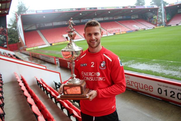 FANS' CHOICE: AFC Bournemouth defender Simon Francis with the coveted Micky Cave Trophy