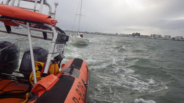 Poole Inshore Lifeboat taking the stricken vessel back to Slipway by Sandbanks. Pic: Poole RNLI