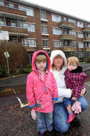 OUT: Penny Alderton, with her children Georgia, three, and Madison, one, outside the block of flats