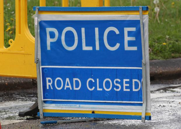 A31 closed after car crashes into hedge