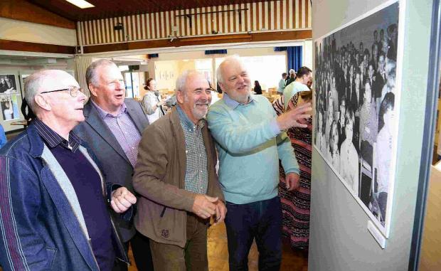 MEMORIES: Former pupils look at some of the photographs on display