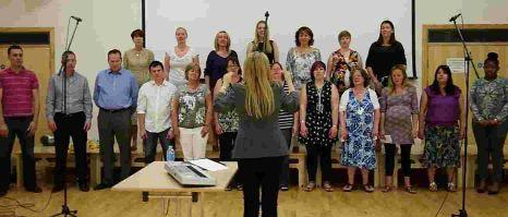 ON SONG: A choir made up of staff from the law firm Frettens sings for a radio advertising campaign under musical director Alison Russell-Hayward